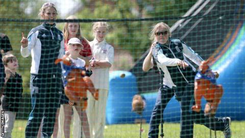 Heather Knight (right) and England captain Charlotte Edwards at a Chance to Shine coaching session