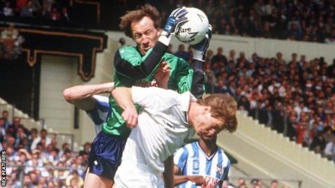 Coventry City keeper Steve Ogrizovic jumps above Tottenham and Scotland defender Richard Gough to take a high ball at Wembley in 1987