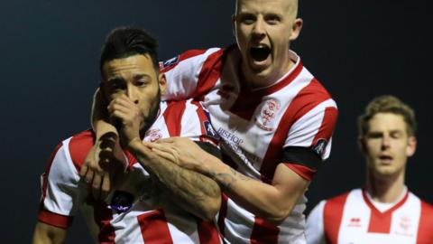 Lincoln's Nathan Arnold celebrates the winner against Ipswich