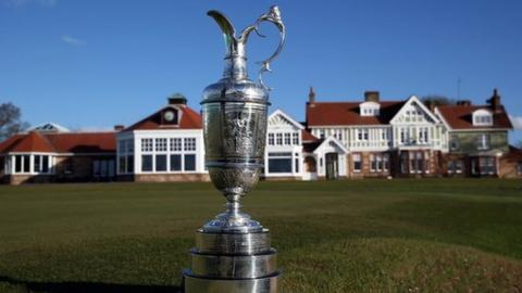The Claret Jug trophy beside the 18th green in front of the clubhouse during The Open Championship media day at Muirfield on April 29, 2013