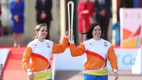 "Victoria Pendleton and Anna Meares carry the baton at the launch of the Queen""s Baton Relay"