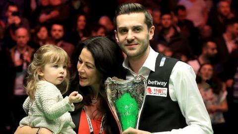 Mark Selby celebrates winning the UK Championship with his family