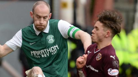 Hibernian's David Gray in action against Hearts' Sam Nicholson