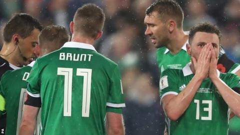 Northern Ireland were stunned by referee Ovidiu Hategan 58th-minute penalty decision