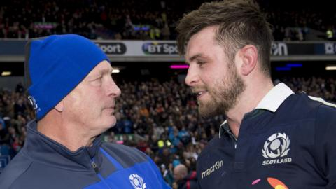 Scotland coach Vern Cotter enjoys the win with Ryan Wilson