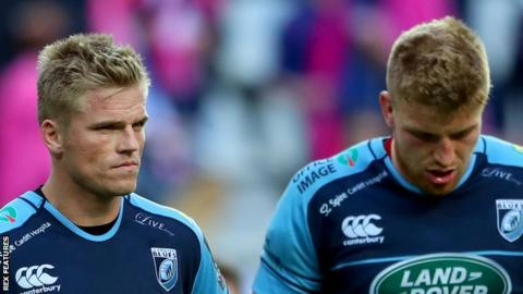 Gareth Anscombe and Macauley Cook are despondent after defeat in Paris