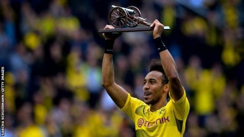 Dortmund's Gabonese forward Pierre-Emerick Aubameyang lifts the trophy as the Bundesliga's top-scorer