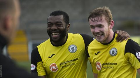 Captain Joe Mbu (left) celebrates with Lewis Allan at the final whistle as City secure three points at Station Park
