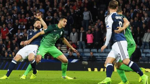 Scotland's Robert Snodgrass and Lee Griffiths look on as a Russell Martin goal is disallowed