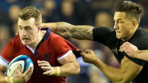 Scotland's Stuart Hogg (left) in action against New Zealand