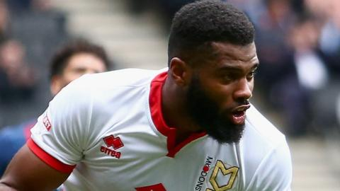 Ethan Ebanks-Landell of Milton Keynes Dons celebrates scoring
