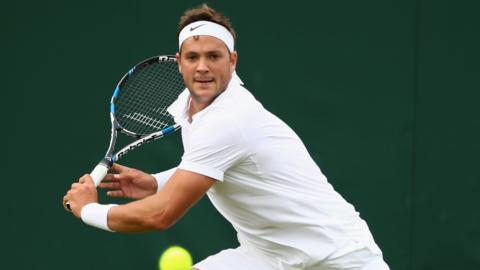 Marcus Willis plays a shot