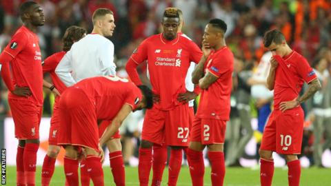 Liverpool's players react after losing the Europa League final 3-1 to Sevilla