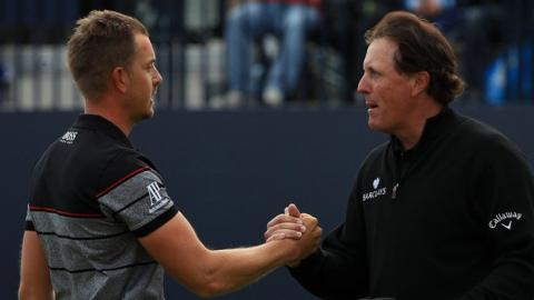 Henrik Stenson shakes hands with Phil Mickelson