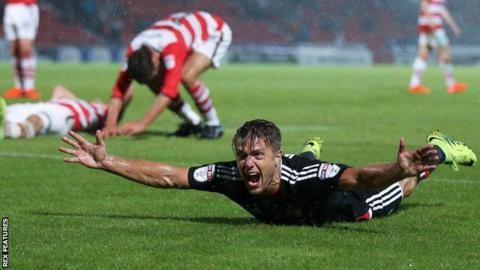 Jamie Ward celebrates scoring for Nottingham Forest against Doncaster in the League Cup