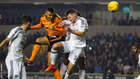 Romain Saiss heads in Wolves' opening goal against Fulham