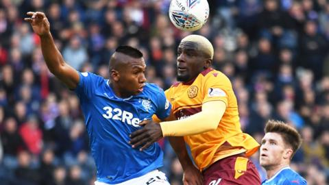 Rangers striker Alfredo Morelos contests the ball with Motherwell's Cedric Kipre
