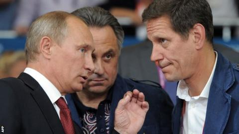 Russian president Vladimir Putin and sports minister Vitaly Mutko