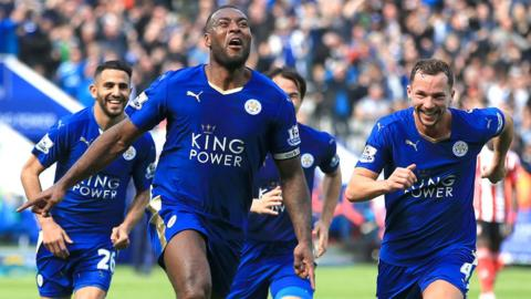 Leicester City players celebrate with captain Wes Morgan after he scored against Southampton