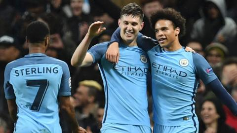 Raheem Sterling celebrates with John Stones