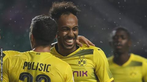 Pierre-Emerick Aubameyang says he is staying at Borussia Dortmund