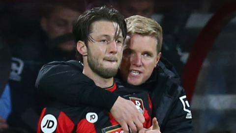 Bournemouth manager Eddie Howe talks to Harry Arter during the game against Manchester United in December