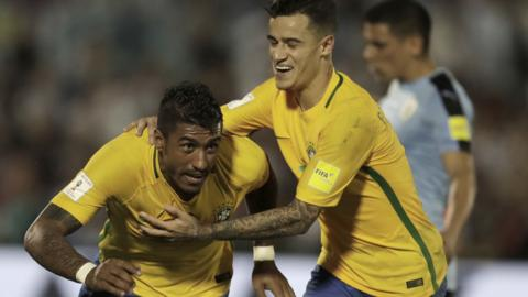 Paulinho and Philippe Coutinho celebrate for Brazil