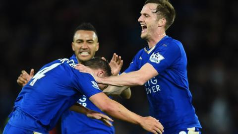 Andy King (right) celebrates a goal with Danny Simpson and Danny Drinkwater