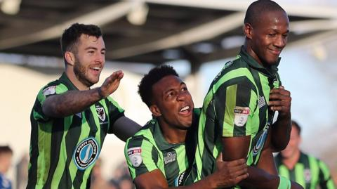 AFC Wimbledon celebrate their last-minute winner