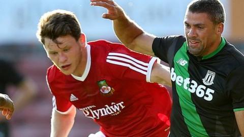Wrexham's Connor Jennings in action against Stoke City