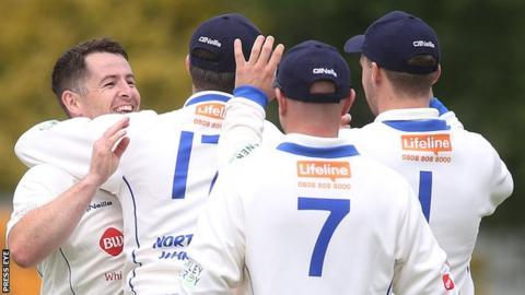 North West Warriors celebrate one of Davy Scanlon's wicket