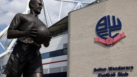 A general view of Bolton's Macron Stadium with the statue of Nat Lofthouse outside