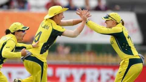 Australia celebrate dismissing Mandhana
