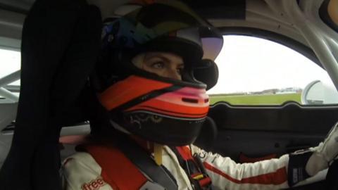 Esmee Hawkey driving a Porsche Cayman GT4
