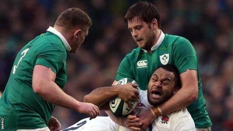 Iain Henderson tackles Billy Vunipola at the Aviva Stadium