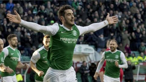 Brian Graham celebrates a goal for Hibs in a 4-0 win over Queen of the South