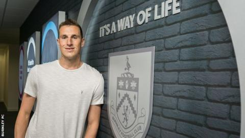 Burnley sign Leeds striker Wood in record deal