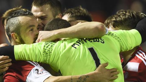 Hamilton congratulate goalkeeper Remi Matthews