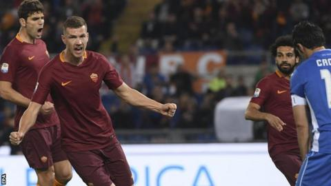 Edin Dzeko celebrates scoring for Roma against Empoli