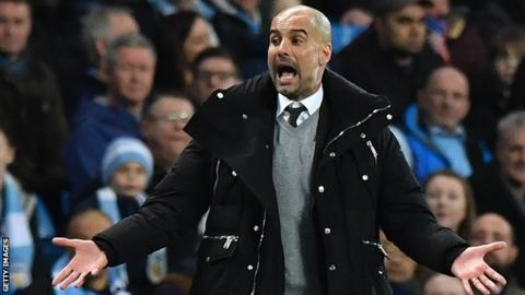 Man City boss Pep Guardiola issues instructions to his players