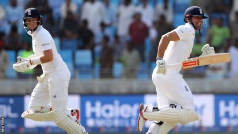 Joe Root and Alastair Cook run between the wickets