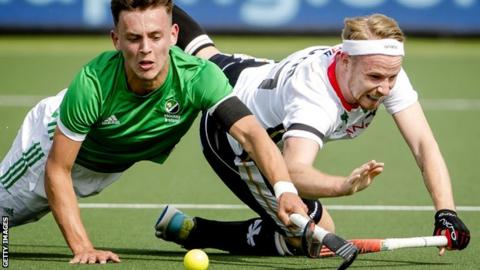 Ireland's Matthew Nelson battles for the ball with Christopher Ruhr of Germany in Amsterdam