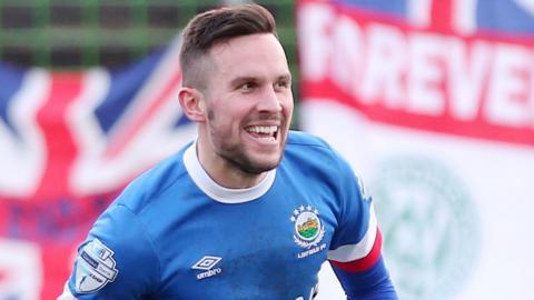 Linfield striker Andrew Waterworth celebrates scoring against Glentoran