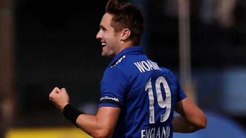 Chris Woakes of England celebrates
