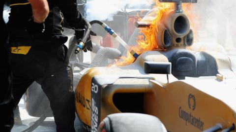 Kevin Magnussen's Renault catches fire