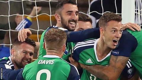 Northern Ireland celebrate Jonny Evans' goal