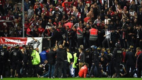 Shocking footage shows barrier breaking as fans injured during French soccer match