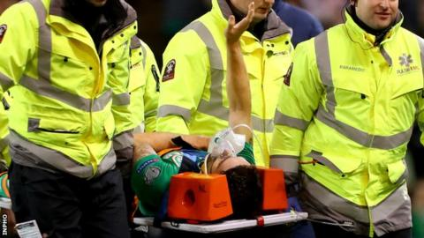 Robbie Brady waves to the crowd as he is stretchered off late in Thursday's game