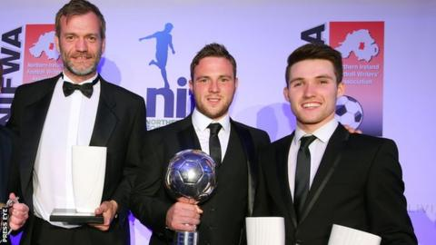 Linfield players Roy Carroll, Jamie Mulgrew and Paul Smyth with their awards in Belfast