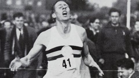 Sir Roger Bannister (finish line) runs under four minutes on 6 May 1954